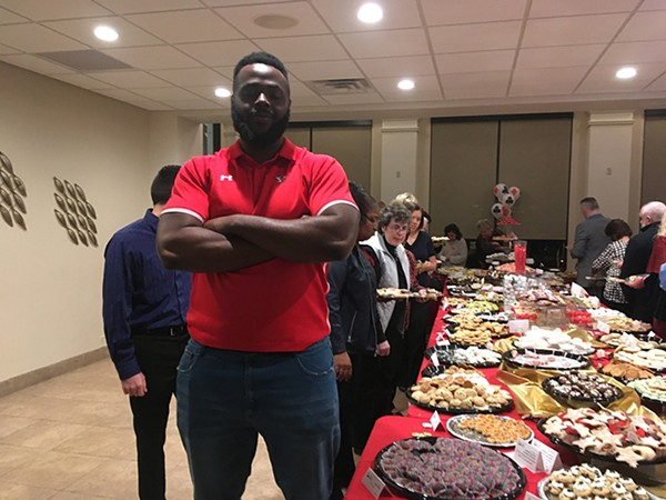 Cookie table security provided by Youngstown State University football team's defensive line - BONNIE TAWSE
