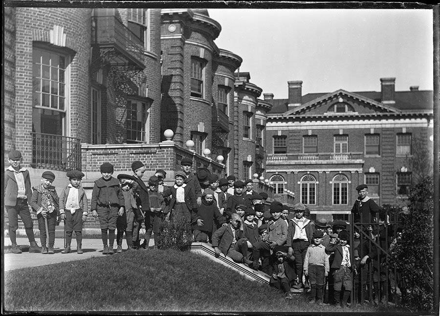 Children gathered outside of the Chicago Orphan Asylum - RUDOLPH F. MICHAELIS / COURTESY NEWBERRY LIBRARY