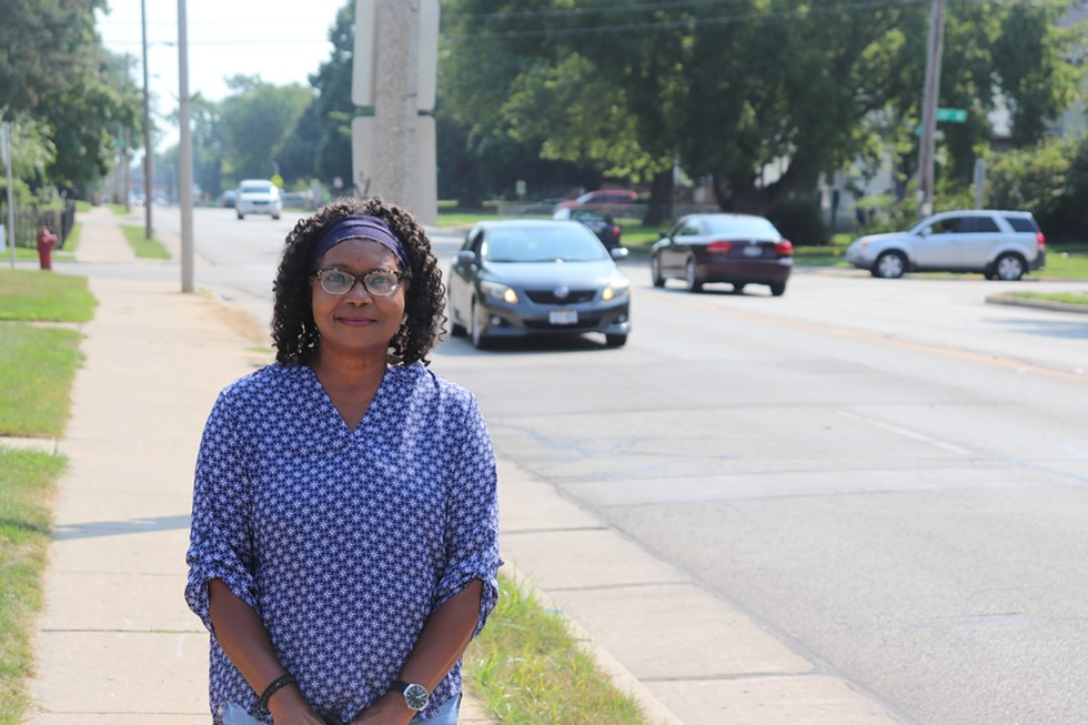 Adelene Greene stands at the intersection of 60th street and 20th avenue in Kenosha on Wednesday, August, 26, 2020. - ADAM MAHONEY / INJUSTICE WATCH