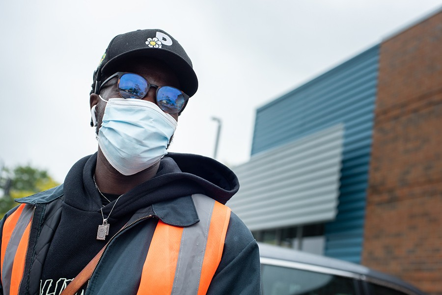 Femdot, aka Femi Adigun, coordinates volunteers in the Aldi parking lot at 2600 N. Clybourn. - MATTHEW GILSON FOR CHICAGO READER