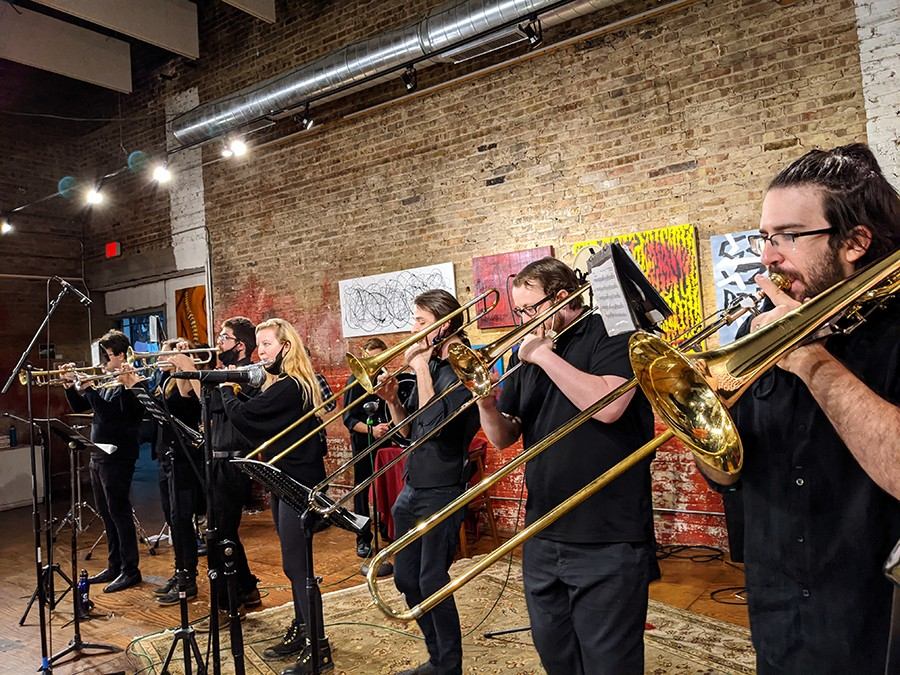 From left: trumpet players Nick Kaplan, Emily Kuhn, and Matt Riggens; flutist Stella Vie; and trombonists Dominic Gaietto, Nick Roach, and Ben Zisook. - RAVEN GEARY FOR CHICAGO READER