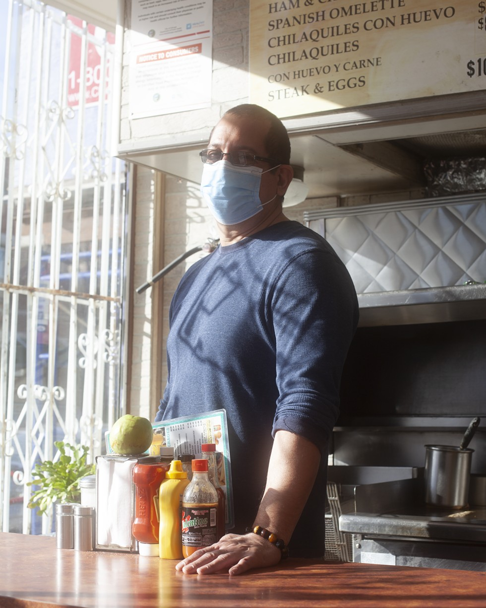 Nelson Perez who runs the family business Park View Diner (owned by mother Maria Solis) works a normal day amid the pandemic, with head chef Laura. - SAMANTHA CABRERA FRIEND