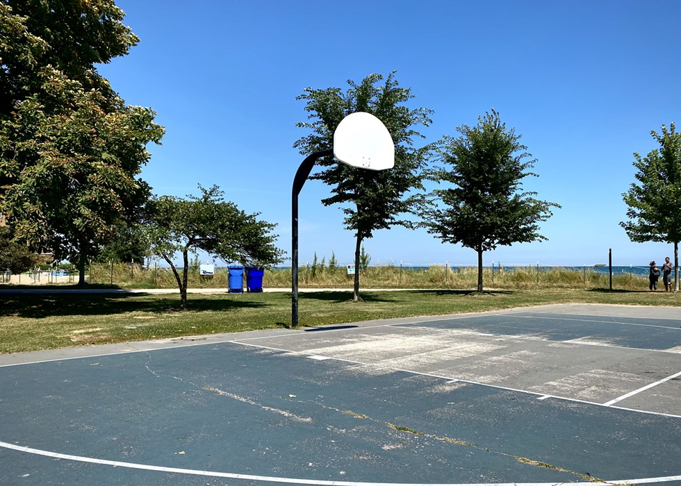 The Loyola Park basketball court in Rogers Park without rims in August 2018. Loyola Park does not feature on the Chicago Park District's list of inactive courts, and it is unclear why the rims here have not been restored here since Chicago resumed park access in its  phased reopening. - ALISON SALDANHA