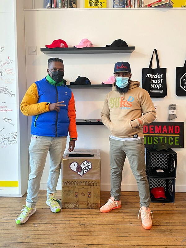 Matt Muse (left) and Trap House Chicago owner Mashaun Ali at the brand's Wicker Park  store, one of six drop-off spots for the Love & Nappyness Hair Care Drive - PHOTO BY IMAGINAT
