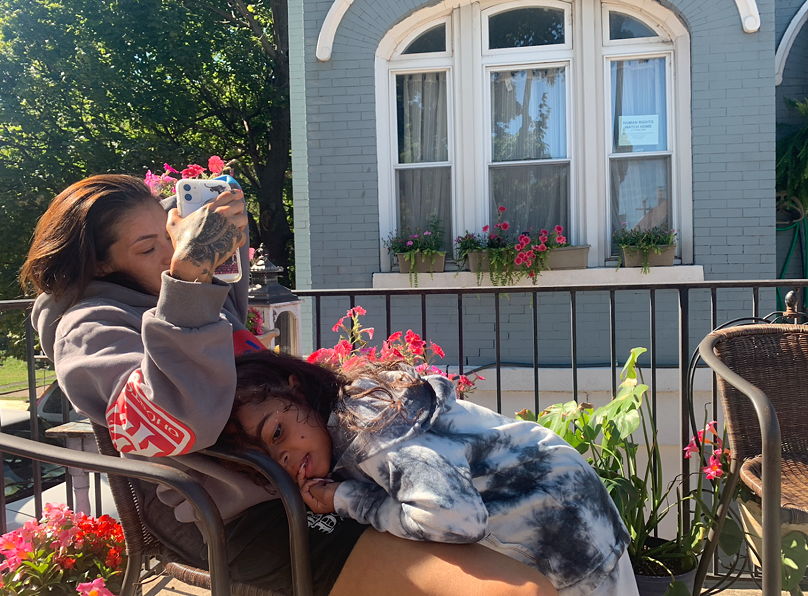 Tanya Lozano chats on FaceTime outside of her family home with daughter Apollonia Jackson in her lap. - NEENA ROUHANI