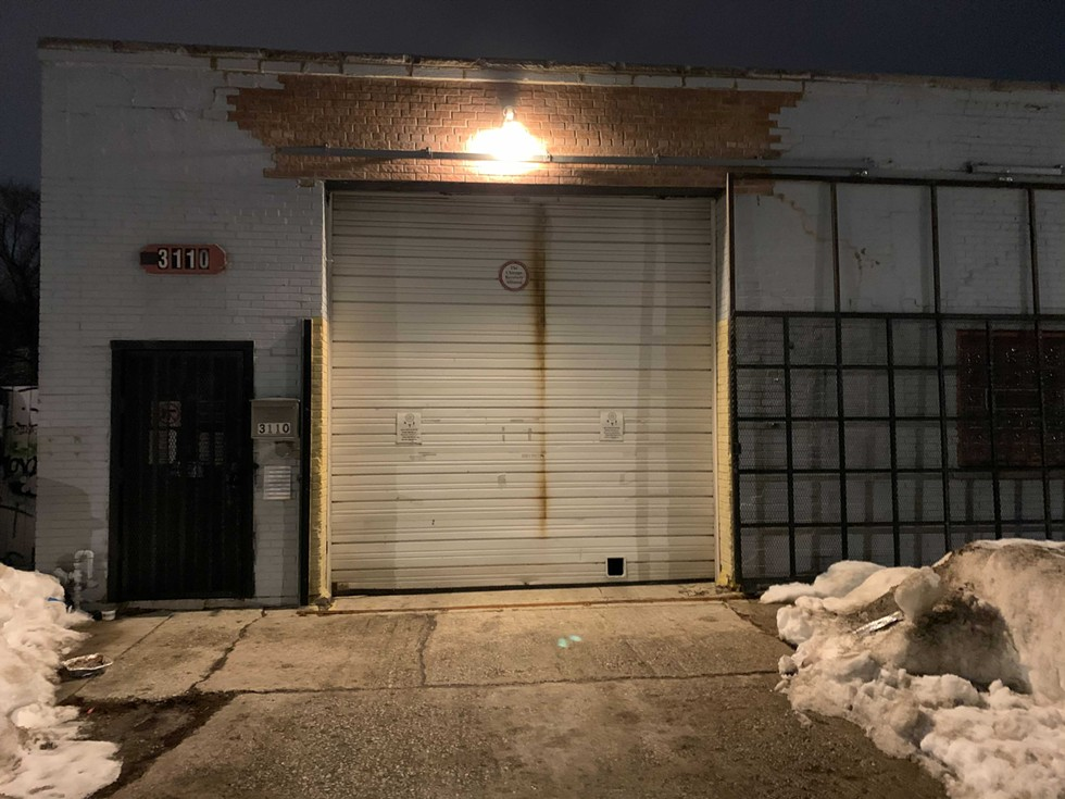 The west side garage where a man was found unresponsive in his car