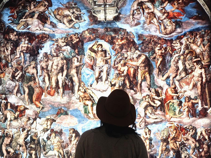 A viewer takes in Michelangelo's The Last Judgment. - COURTESY THE ARTIST