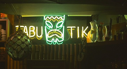 Tiki collectors escape winter in their basement paradise