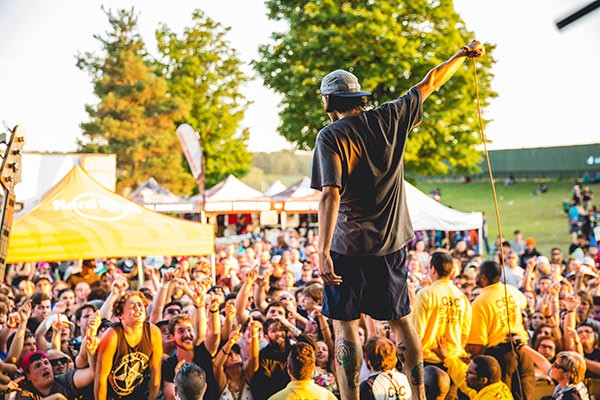 Knuckle Puck front man Joe Taylor onstage at Warped Tour in Darien Center, New York, on July 15