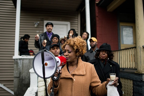 Evelyn Glover-Jennings holds a prayer with her family and west-side officials on December 27, the day after her cousin Bettie Jones was shot and killed by Chicago police.