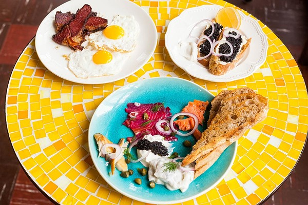 Clockwise from top left: brisket and eggs, sourbread toast with black sturgeon roe and creme fraiche, and the preserved fish plate
