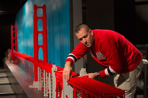 Adam Reed Tucker poses with his model of the Golden Gate Bridge.