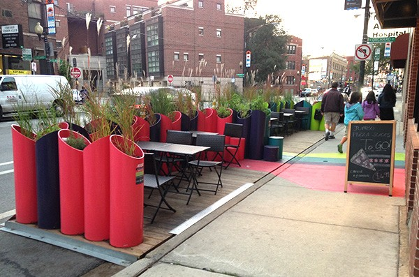 """This """"people spot"""" by Osteria de Pizza Metro got little use because passersby mistook it for a private sidewalk cafe."""