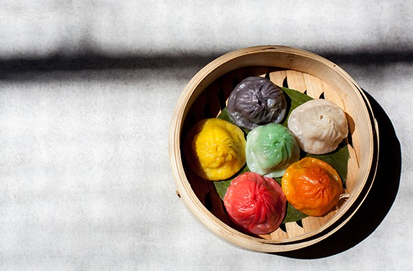 The xiao long bao (soup dumplings) are color coded to telegraph the contents of their interior—but they look like lumps of carcinogenic Play-Doh.