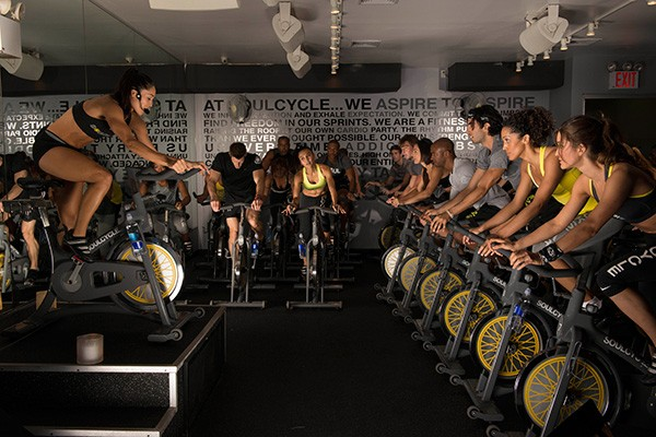 Taking place in candlelit rooms and led by impassioned instructors delivering inspirational phrases, SoulCycle's spin classes can feel churchy.