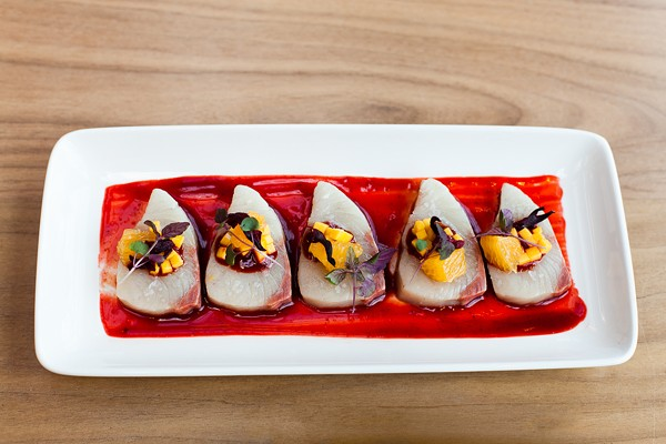 Yellowtail in a sauce of guajillo chile and hibiscus flower, with mango relish garnish
