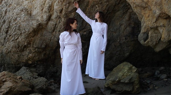 "Laura Callier and Whitney Johnson in a still from Simulation's forthcoming video for the song ""To"""