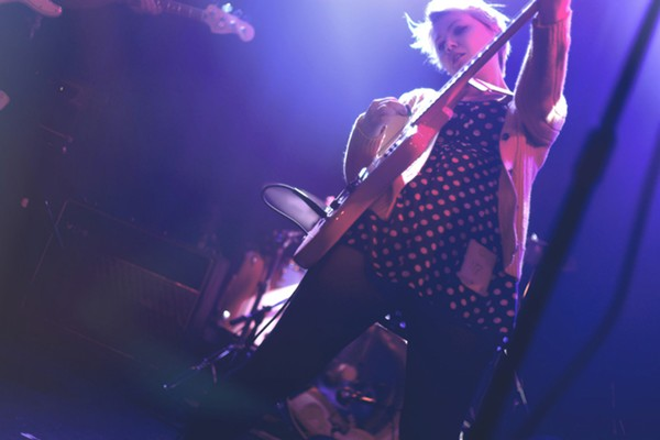 Shannon Candy, founder of Bernice Records and Tapes, onstage with Strawberry Jacuzzi