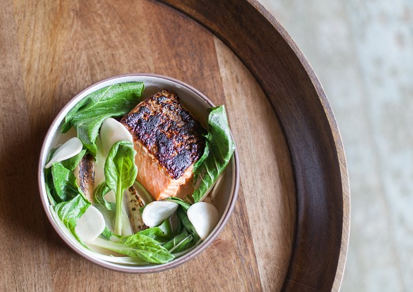 A luscious broiled sea trout fillet bathes in a broth boosted with glutamic sake lees.