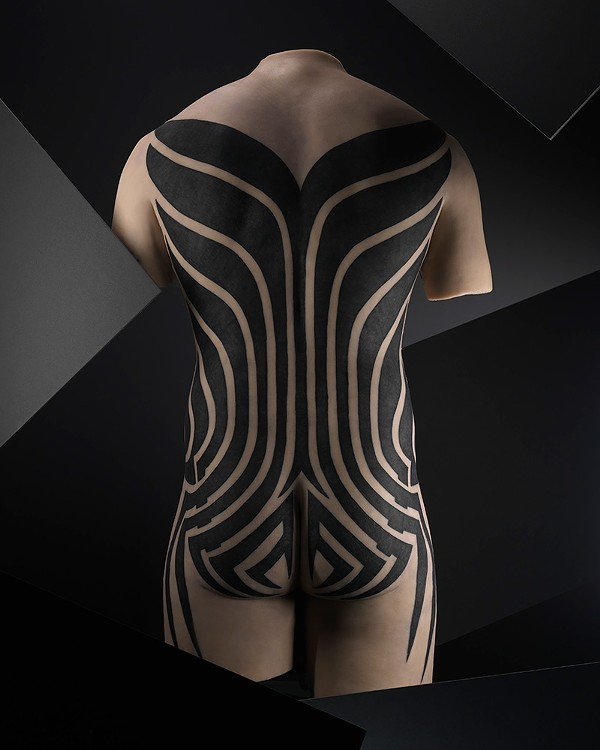 "A design by Ann Arbor-based tattoo artist Leo Zulueta, known as ""the father of modern tribal tattooing"""