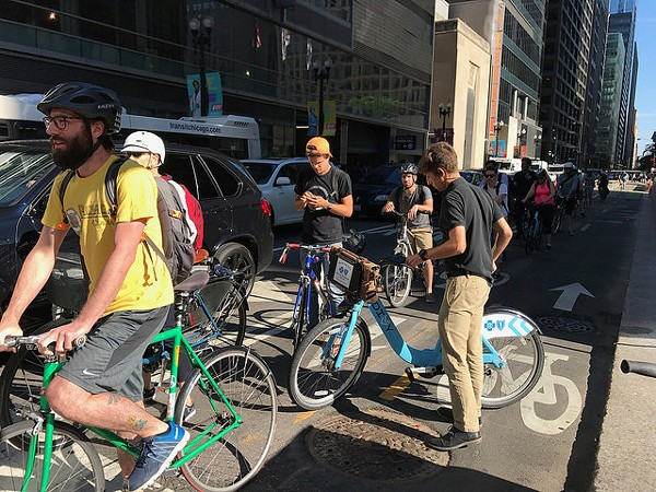 Bike riders wait for a green light at Dearborn and Randolph. Cutting to the  front 5d209a449