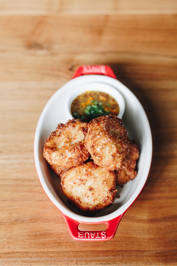 The chicken nuggets, jacketed in a crackly, razor-thin batter, bear a tongue-tingling hit of jalapeño.