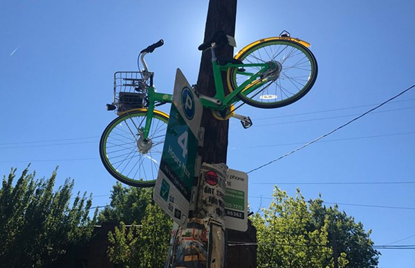 Dockless bike-share users in Seattle have left the cycles in many strange spots, even hanging from street signs.