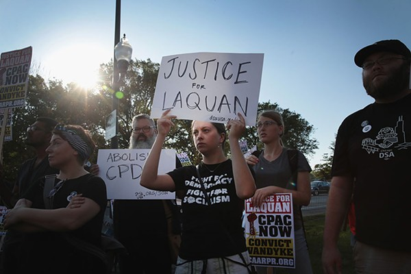 Demonstrators protest outside the Leighton Criminal Courts Building during jury selection.