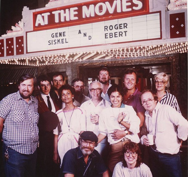 Andrea Gronvall (bottom right) with the crew of At the Movies, where she was a producer for 17 years.