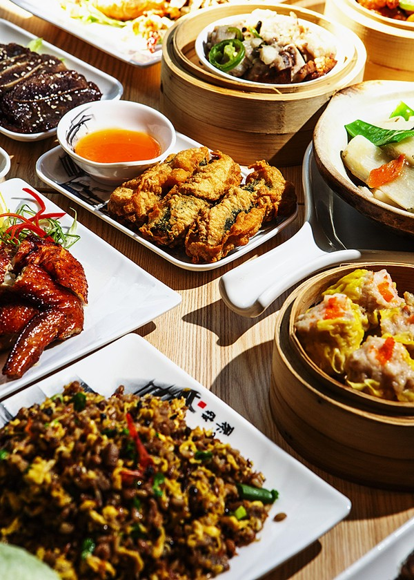 Clockwise from top left: short ribs, steamed spareribs, Chinese yam with mustard greens, siu mai, minced beef and wild rice with lettuce and XO sauce, Guangzhou-style roasted chicken, crabmeat with seaweed