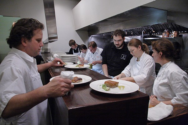 Paul Kahan expediting at the pass during the Reader's Whole Hog Project dinner