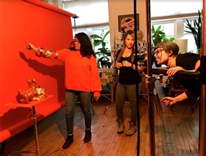 Yazmin Dominguez, media partnerships coordinator for the Reader poses for the Arts & Culture shoot. Photographer Lisa Predko sets up the shot with help from Readerdirector of photography Jamie Ramsay. - LENI MANAA-HOPPENWORTH FOR CHICAGO READER