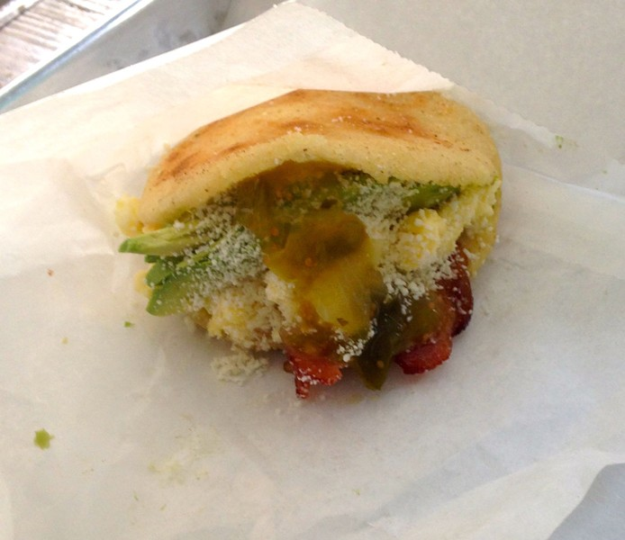 Puesto Sandwich Stand's chilaquiles-stuffed arepa is a masterpiece of balanced sandwich construction. - AIMEE LEVITT