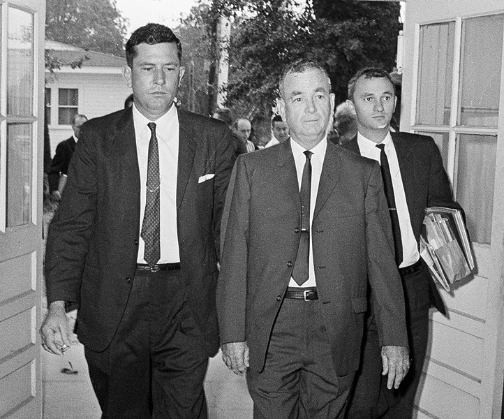 Tom Coleman, center, flanked by attorneys, arrives at the Hayneville, Alabama, courthouse to stand trial for the slaying of civil rights worker Jonathan Daniels.