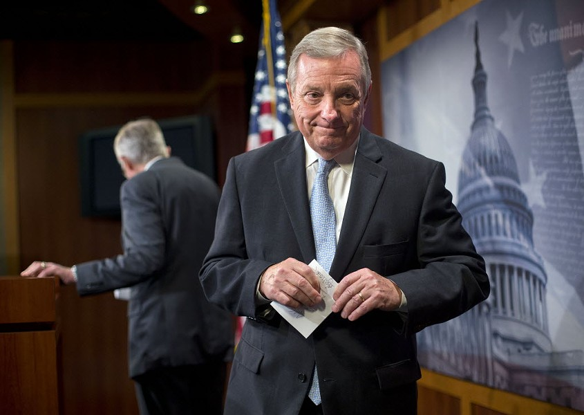 Senator Dick Durbin leaves the stage after answering questions about Democrats protecting President Obama's Iran deal - PABLO MARTINEZ MONSIVAIS