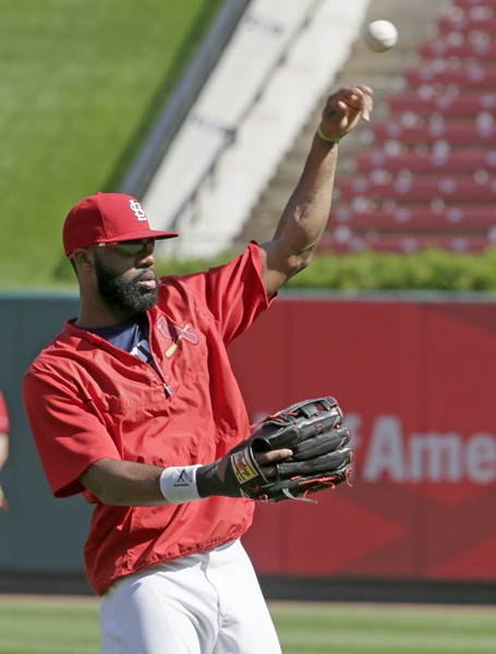 Jason Heyward warming up yesterday - TOM GANNAM/AP PHOTOS