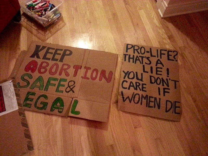 Posters from last year's counterprotest against the March For Life - COURTESY FURIE