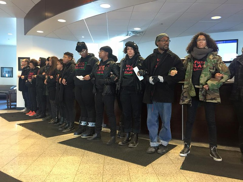 "BYP 100 protesters wore sweatshirts emblazoned with the phrase ""Fund Black Futures"" during Saturday's shutdown of a police-affiliated credit union. - FACEBOOK"