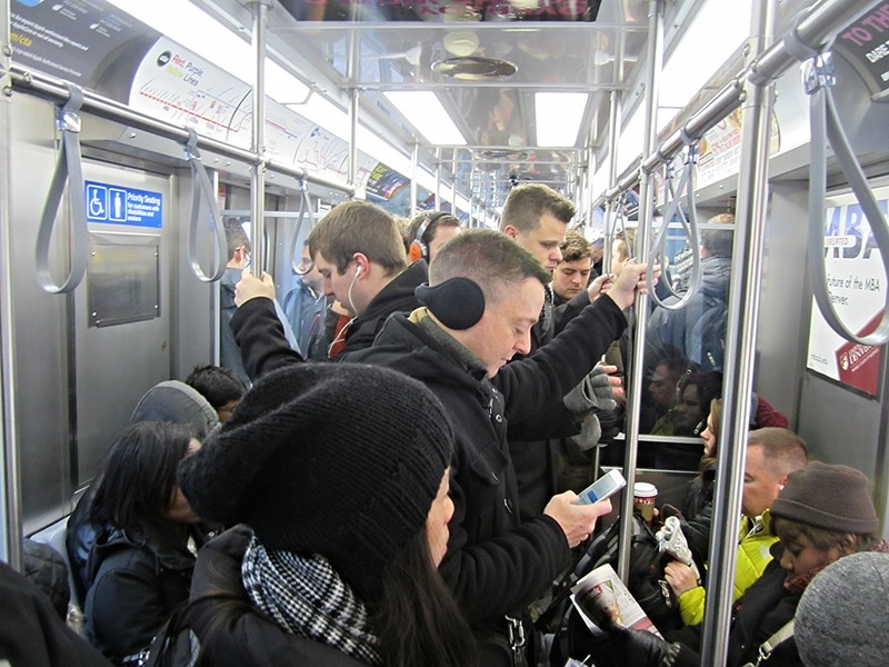 A crowded inbound Red Line car during the morning rush last week. - JOHN GREENFIELD