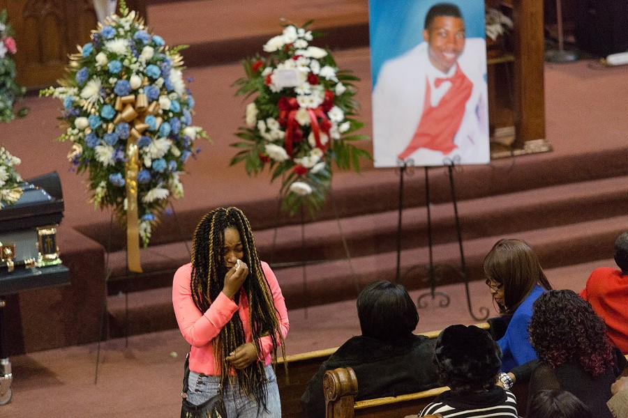A woman breaks into tears during the January 9 funeral service for Quintonio LeGrier. - LOU FOGLIA FOR THE SUN-TIMES