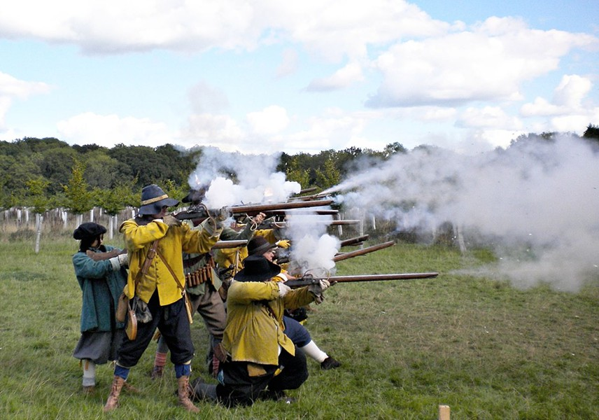 Musket volley by English civil war reenacters in West Sussex. - WIKIPEDIA