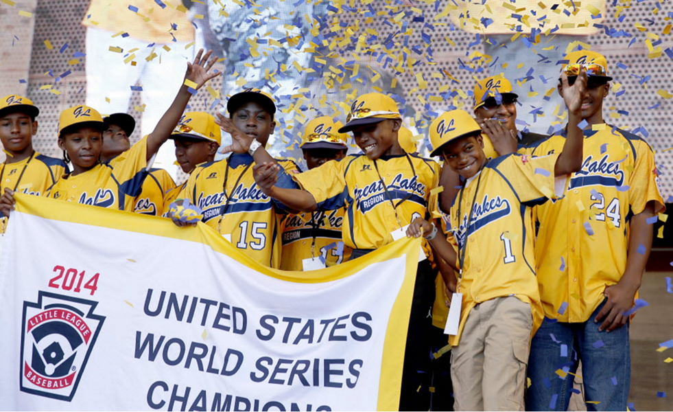 The Jackie Robinson West All Stars Little League baseball team celebrates its 2014 Little League Championship. The team was later stripped of its title. - AP PHOTO/CHARLES REX ARBOGAST, FILE