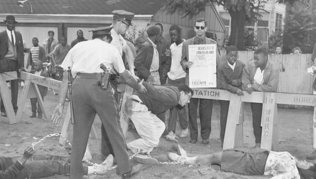Chicago policemen arrest Bernie Sanders near 73rd and Lowe on August 13, 1963. - SUN-TIMES