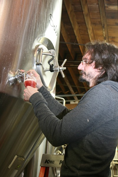 Laffler pulls Wari Ale from the tank. - JULIA THIEL