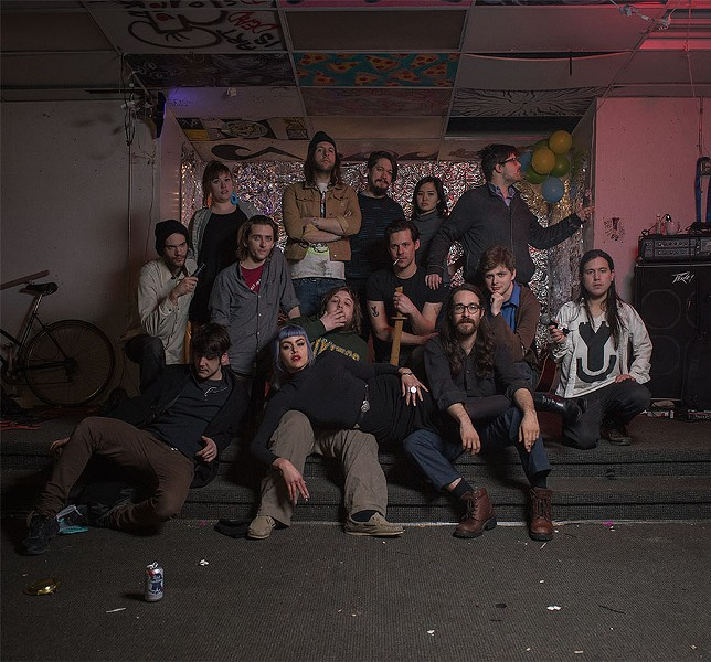 Shortly before moving out at the beginning of March, Young Camelot knights gather in the first-floor space of the church where they hosted events from October 2014 till January 2016. From left to right: Colin Mulhern, Donnie Love (seated), Maureen Neer, Jeffrey Carl Mull, Emily Esperanza, Matt Gonzalez (arms crossed), Shane Prentice-Walz, Alex Rowney, Joey Eichler, Trina Certeza, Matt Uribe, Phillip Christian Swafford (pointing), Daniel Mozurkewich, and Chris Lee. - JOHN STURDY