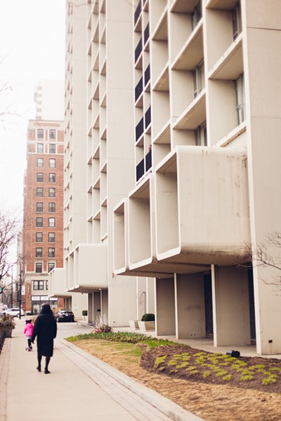 The boxes that jut out of the second floor of Harbor House, on Belmont and Lake Shore Drive, were added to correct a surveying oversight. - DANIELLESCRUGGS