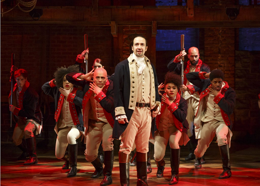 Lin-Manuel Miranda, foreground, with the cast of Hamilton, during a performance in New York. - JOAN MARCUS/THE PUBLIC THEATER VIA AP