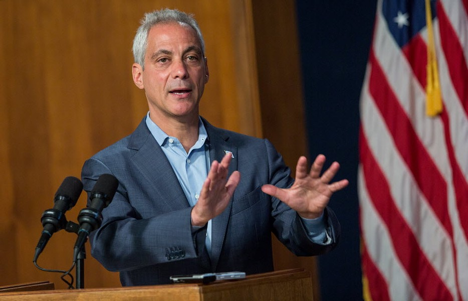 Mayor Rahm Emanuel speaks to reporters Tuesday at City Hall about improvements in funding for Chicago's police and fire pensions. - LOU FOGLIA/SUN-TIMES