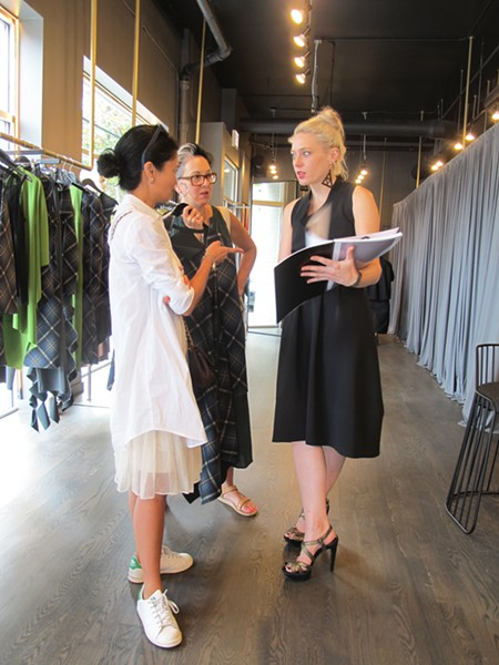 Stylists Arlene Matthews and Brandon Frein learn about the new fall collection. - ISA GIALLORENZO
