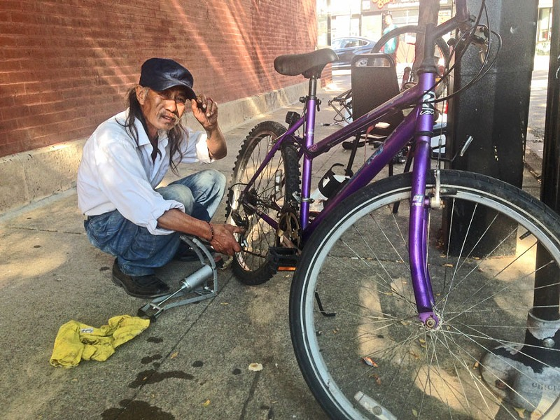 Kent Moy and his makeshift bike repair shop - JOHN GREENFIELD